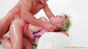 Short-haired blonde MILF with juicy tits gets analized
