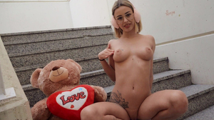 Geeky gal strips naked and happily fucks in public